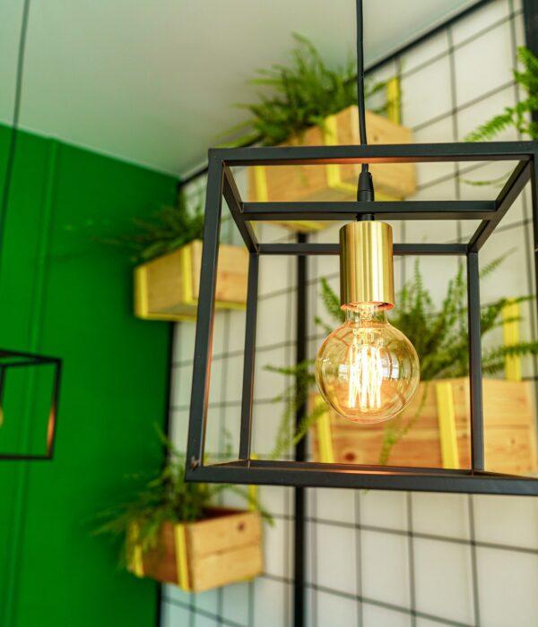 Creative loft style lamp with shining lightbulb
